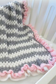 #Crochet baby blanket pattern with beautiful ruffles! Adorable, fast and easy to make with a basic granny stitch. Cute stripes and sweet ruffles, change the colors for a bab... #crochet #knit