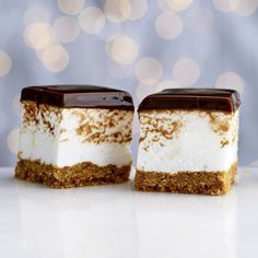 Dark Chocolate Marshmallow Bars —These mile-high bars pack the tastes of your favourite fireside treat into a decadent layered holiday dessert. Homemade marshmallow may sound difficult, but it is surprisingly easy to make and well worth the effort. Holiday Desserts, No Bake Desserts, Dessert Recipes, Bar Recipes, Holiday Treats, No Bake Treats, Yummy Treats, Sweet Treats, Eat Dessert First
