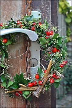 Here's a new perspective on the traditional wreath- create a smaller version and hang it on your door knob! Or on your garden door knob- even better! holiday decorations. gardens. garden doors.