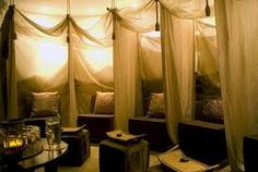 Loung area - softly lit, drapey fabrics, and the choice to interact with other people or not.