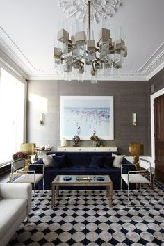 Eclectic Living Room with Tufted blue velvet sofa, Hardwood floors, specialty window, Standard height, Wall sconce