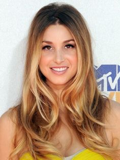 Ombre hair styles are all about amplifying hairs natural tendency to be darker at the roots and lighter on the ends. With a warm base that graduates subtly into long blonde highlights