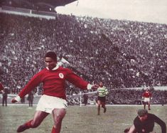 Benfica goal ace Eusebio scores against rivals Sporting Lisbon in 1964.