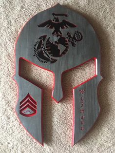 Items similar to Metallic Painted EGA USMC Wooden Spartan Helmet on Etsy Diy Furniture Projects, Diy Pallet Projects, Woodworking Projects, Carved Wood Signs, Painted Wood Signs, Usmc Wallpaper, Military Shadow Box, Wooden American Flag, Wood Flag