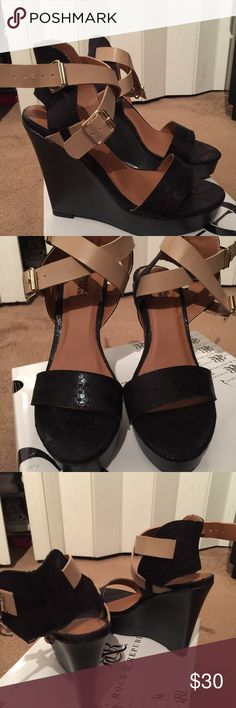 Shoes Black Wedge Heel with Tan crisscross straps, barely worn. You can wear the straps crisscross or straight across. Perfect with jeans, t-shirts and blazer of your choice. Charlotte Russe Shoes Wedges