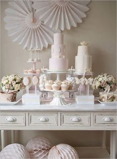 Loving the large pinwheel flowers and the elegant pastel color theme. See all…
