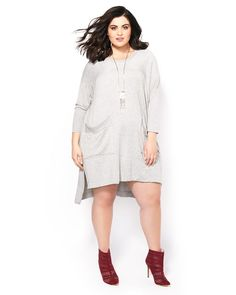 Meet your new comfy spring staple! This plus-size dress from Melissa McCarthy offers total comfort thanks to its super soft french terry fabric and relaxed t-shirt dress style. It has a scoop neck, 3/4 dolman sleeves, fashionable, front pockets and a high-low hem with side slits. Designed to be worn as a dress or tunic!