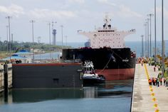 A post-panamax bulk carrier became the first ship to pass through the Panama Canal's new locks on Thursday, kicking off a series of trial runs ahead of the expanded canal's grand opening later this month. The $5.3 billion expansion project involves the construction of a new set of locks on both the Atlantic and Pacific sides and multiple dredging projects to create a second lane of traffic along the canal. The new locks are much wider and deeper than the current locks.