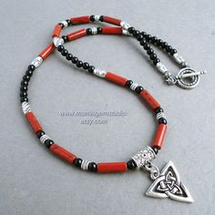 Mens Necklace, Black and Red Gemstone with Celtic Knot Triquetra Charm, Beaded Necklace for Men, Guys, Him, Handcrafted by mamisgemstudio on Etsy https://www.etsy.com/listing/168169098/mens-necklace-black-and-red-gemstone