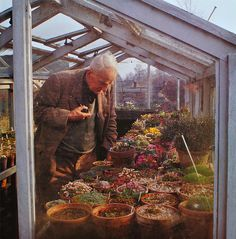 J.R.R. Tolkien in his greenhouse  HE HAS A MONOCLE .