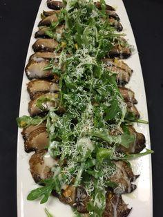 Warm portobello mushroom carpaccio ,topped with arugula salad, pistachio and an apple cider vinaigrette!
