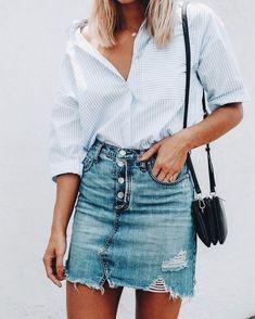 Trendy distressed denim mini skirt with simple striped shirt.