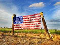 """""""God Bless America"""" - American flag made from styrofoam and red and blue Solo cups - near Panther Burn, Mississippi - Taken on 3/30/12 - Delta iPhoneography - Order prints from www.flatoutdelta.com -  © 2013 John Montfort Jones"""