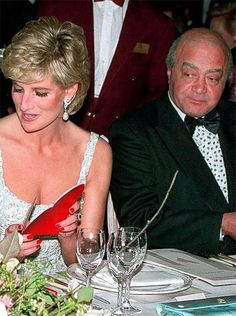Princess Diana seated next to Mohammed Al Fayed (Dodi's father).