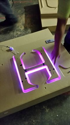 This pic shows Hayden at VFX Foam working on a mockup for some backlit LED lighting we're adding to letters on a sign we're making for a client. Tv Wall Design, Tile Design, Door Name Plates, Signage Board, Neon Box, Light Font, Building Signs, Light Letters, Cnc Projects
