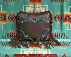 This #Western style #pillow rocks brown and turquoise #leather filigree overlay with sterling and turquoise conchos. . .and don't forget the matching pillows! stargazermercanti...