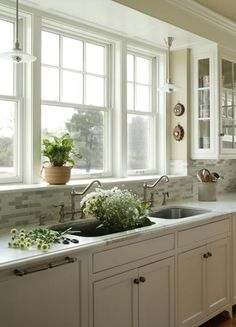 Great window/sink look and the right cabinets