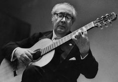 Andres Segovia playing classical guitar.