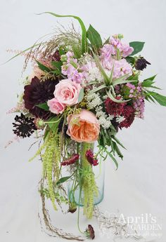 Lush and romantic this bridal bouquet is really prefect for all seasons. Air plants, Garden roses, Scabiosa, Dahlias and so much more make this bouquet very special. #romanticwedding #pink Flowers by April's Garden in Durango, CO http://www.durangoflorist.com/