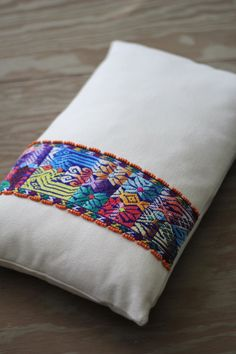 Guatemalan pillow cover with handwoven belt by LorenzaFilati on Etsy https://www.etsy.com/listing/213871393/guatemalan-pillow-cover-with-handwoven