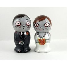 Zombie wedding cake toppers. @Megan Martin, do you think I'd get weird looks it this was on top of my cake?