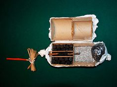 How Fireworks Work by popularmechanics: Here is a 6-inch cylindrical shell. The time delay fuse is at the far left; square stars are in the left compartments; and the bursting charge extends through from the fuse to the black lift powder at right. #Fireworks #popularmechanics