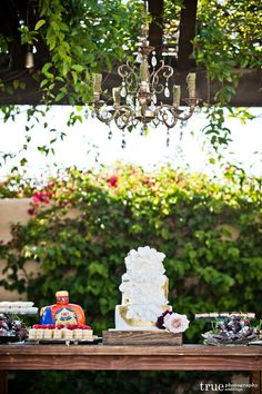 Surrounded by green, nature, outdoor wedding, dessert table, antique chandelier, beautiful florals Lauren Sharon Vintage Rentals and Design | Wedding Rentals San Diego