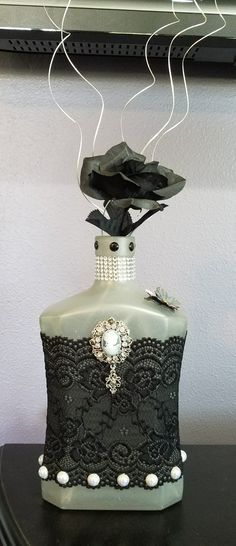 Grey frosted bottle with lace