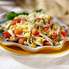 Corn and Tomato Pasta Salad:  Fresh tomatoes and corn bring summer-fresh flavor to this salad. To make it a meatless main dish, omit the chicken and add two tablespoons of grated cheese per serving.