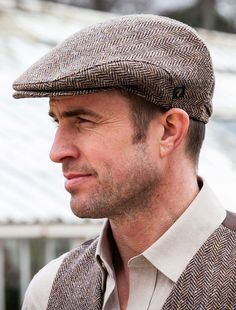 The Aran Sweater Market suggests you try on our Trinity Tweed Flat Cap in Grey. Authentically made in Ireland using the finest Irish tweed, add a heritage inspire look to any outfit with our Irish Cap in Grey Rugged Style, Irish Fashion, Men Fashion, Fashion Guide, Fashion Hats, Irish Hat, Driving Cap, Beard Model, Mens Fashion Sweaters