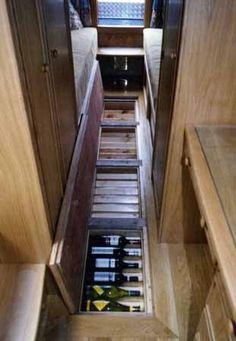 Wine storage for your RV - Wish I had this right now if just for an additional layer of insulation on the floor. - adventureideaz.com