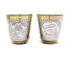 Pair of 17th century German parcel gilt engraved silver beakers, Nuremberg c.1643, make...