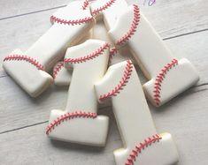 Baseball Birthday Decorated Sugar Cookies - baseball first birthday -baseball 1 - baseball number cookies- athlete - baseball - Sportive - Baseball First Birthday, First Birthday Cookies, Baby Boy 1st Birthday, Baseball Party, First Birthday Parties, Birthday Party Themes, First Birthdays, Baseball Shirts, Baseball Cap