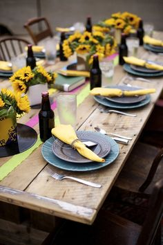 sunflower centerpieces and bottled beer
