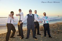 Sunglasses can make not just any group of guys look cool. Love this groom and groomsmen having fun with Dream Beach Wedding