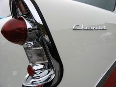 The distinctive tail light of a 1956 Chevrolet