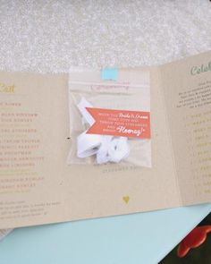 This bride used washi tape to attach little bags of paper streamers for the guests to toss as they walked up the aisle