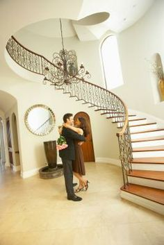 Ideas for niche by curving staircase on pinterest curved for Furniture for curved wall in foyer