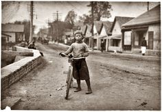 Waco, Texas. November 1913. Isaac Boyett: The twelve-year-old proprietor, managermessenger of the Club Messenger Service, 402 Austin Street. The photo shows him in the heart of the Red Light district where he was delivering messages as he does several times a day.  Makes from six to ten dollars a week.   Photograph by Lewis Wickes Hine. (Shorpynote: Isaac was born March 20, 1901, and died in May 1966 in Waco.
