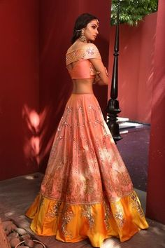 Peach/Mustard mirror and aari work with power shoulder blouse with mirror work details, peach sequence dupatta. Material: Georgette, Lycra Net Dry Clean Only