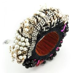 Lost Heart Bangle - by Jolita Jewellery -  New one-of-a-kind piece made with jet black glass beads, lava stone, vintage crystals, faux pearls and vintage chains - chunky and quite heavy piece - The interior is lined with  soft velvet -  Inspired by tribal silver jewellery worn by women in Oman.