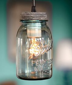 Mason Jar light:  Punch 1in. holes in each mason jar lid (hammer & nail works), unscrew the lid, insert the bulbs into each jar, feeding the cord through the holes in the lid, tighten the lid back on the jar and attach to ceiling using a store-bought light plate with a hole drilled in for cords.