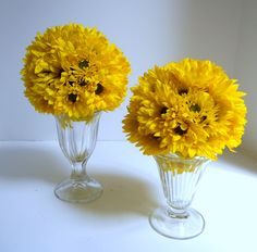 Twin daisy flower balls placed on vintage ice cream sundae containers; used @ a birthday party luncheon.