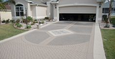 Image from http://static.concretenetwork.com/photo-gallery/images/1200x625Exact_0x60/concrete-driveways_8/decorative-concrete-driveway-stencil-template-custom-ram-design_65380.jpg.