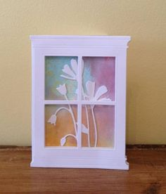 By bluezaki at Splitcoaststampers. The whole card is the shape of the window. Not sure what she used for the colors, but I could sponge on colors for the background.