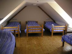 One of the bedrooms in the Gower Cottage. There is a mix of single beds and bunk-beds. Book 1 cottage or book both together for large groups! Attic Doors, Attic Window, Attic Stairs, Basement Bedrooms, Bunk Rooms, Attic Bedrooms, Bunk Beds, Attic Wardrobe, Attic Closet