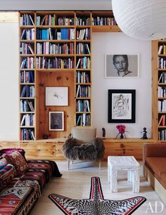 Pine shelving frames works from photographers Inez and Vinoodh's art collection in their New York loft. The circa-1970 faux-bois plaster table is by John Dickinson.