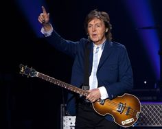 FILE - In this Oct. 15, 2014 file photo, former Beatle Sir Paul McCartney performs in concert as par... - The Associated Press