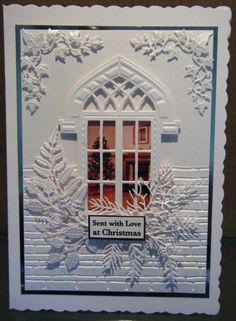 White on White Christmas Card. Used, white pearlised card, new spellbinder brick embossing folder, Marianne window frame CR1259, Marianne Ivys Corner - CR1253 and a selection of tattered lace leaves. by ilene