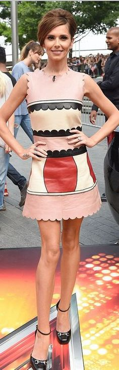 Who made  Cheryl Cole's pink scallop leather dress and black patent pumps?